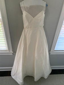 Amsale 'Rowan Silk Faille' size 10 used wedding dress front view on hanger