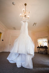 Justin Alexander 'Beautiful' size 4 used wedding dress front view on hanger
