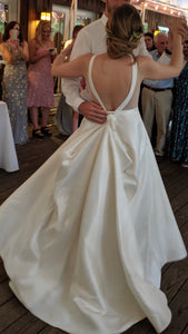 BHLDN 'Octavia' size 4 used wedding dress back view on bride