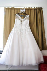 Rebecca Ingram 'Olivia' size 24 used wedding dress front view on hanger