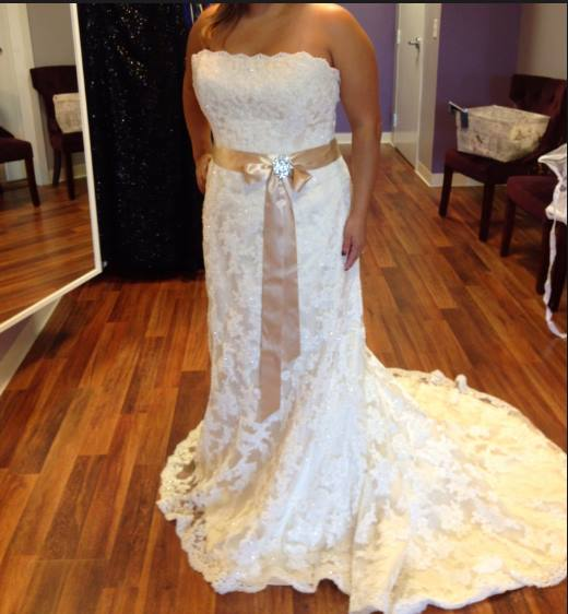 Maggie Sottero 'Karena Royale' size 18 new wedding dress front view on bride