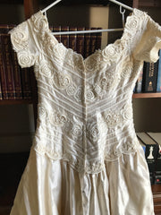 Christos 'Silk' size 8 used wedding dress back view on hanger