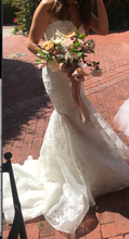 Load image into Gallery viewer, Rivini 'Bullock' size 6 used wedding dress front view on bride