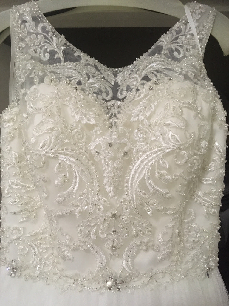 Allure Bridals 'Beaded Illusion' size 8 used wedding dress front view close up on hanger
