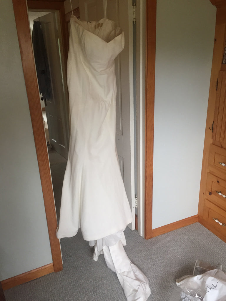 Nicole Miller 'Dakota Faille Trumpet' size 12 used wedding dress front view on hanger
