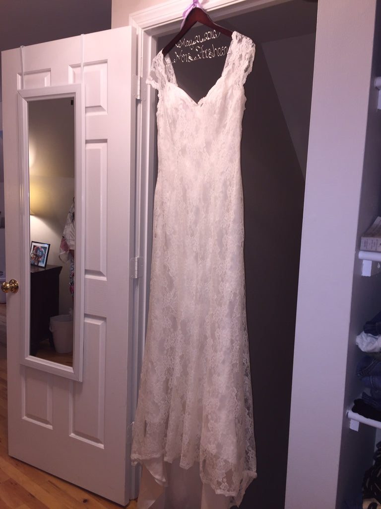 Sweetheart 'Mermaid' size 14 used wedding dress front view on hanger