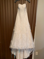 David's Bridal 'Jewel WG3755' size 00 used wedding dress front view on hanger