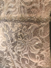 Davids Bridal ' Beaded Lace Trumpet' size 10 new wedding dress close up of fabric