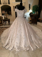Mohammad Murad 'Royal Ball Gown' size 14 used wedding dress front view on mannequin