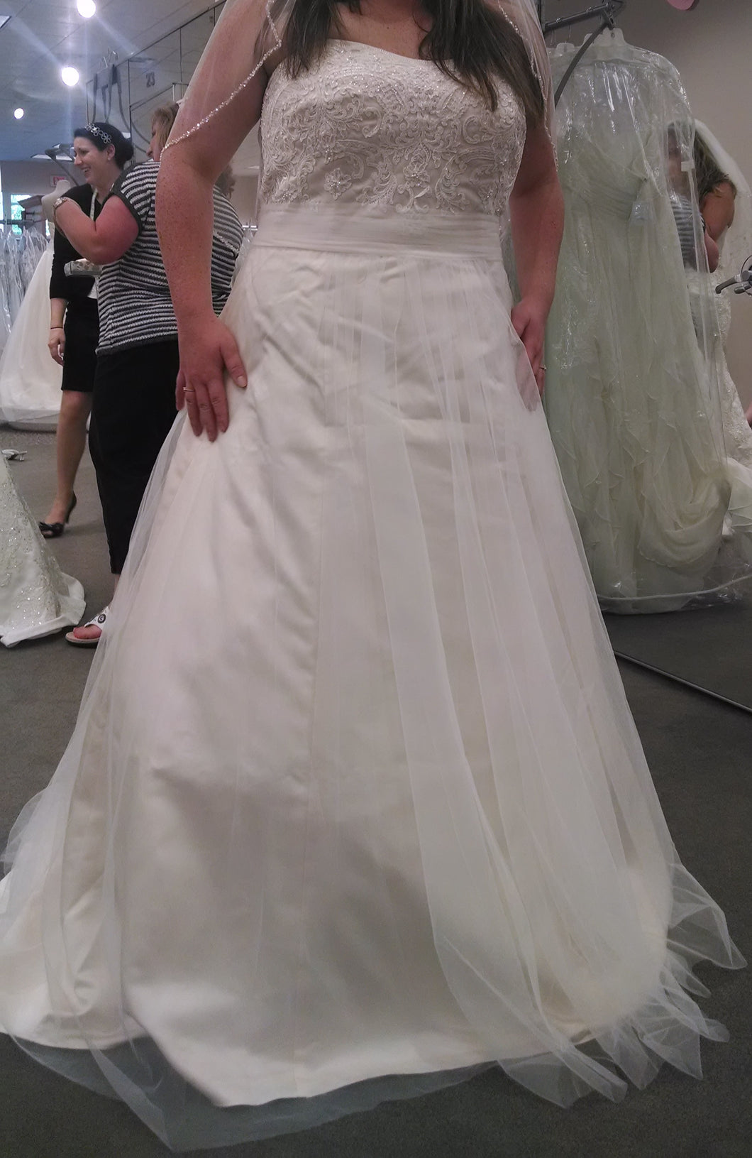 David's Bridal 'Tolle Strapless Soft A' size 16 new wedding dress front view on bride