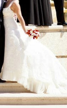 Load image into Gallery viewer, Angel Sanchez 'N821' size 8 used wedding dress side view on bride