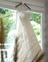 Pronovias 'Alcanar' size 2 used wedding dress front view on hanger