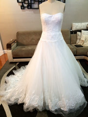 Custom 'New York by Isaac Mizarahi' size 4 used wedding dress front view on mannequin