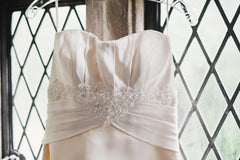 Paloma Blanca '3860' size 4 used wedding dress front view close up on hanger