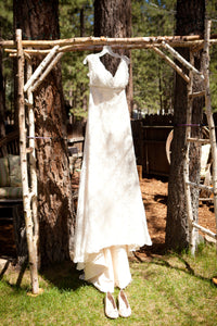 David's Bridal 'Couture' size 10 used wedding dress front view on hanger