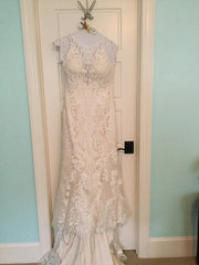 Maggie Sottero 'Winifred' size 4 used wedding dress front view on hanger