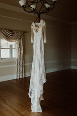 Stella York 'Lace Over Satin' size 4 used wedding dress back view on hanger