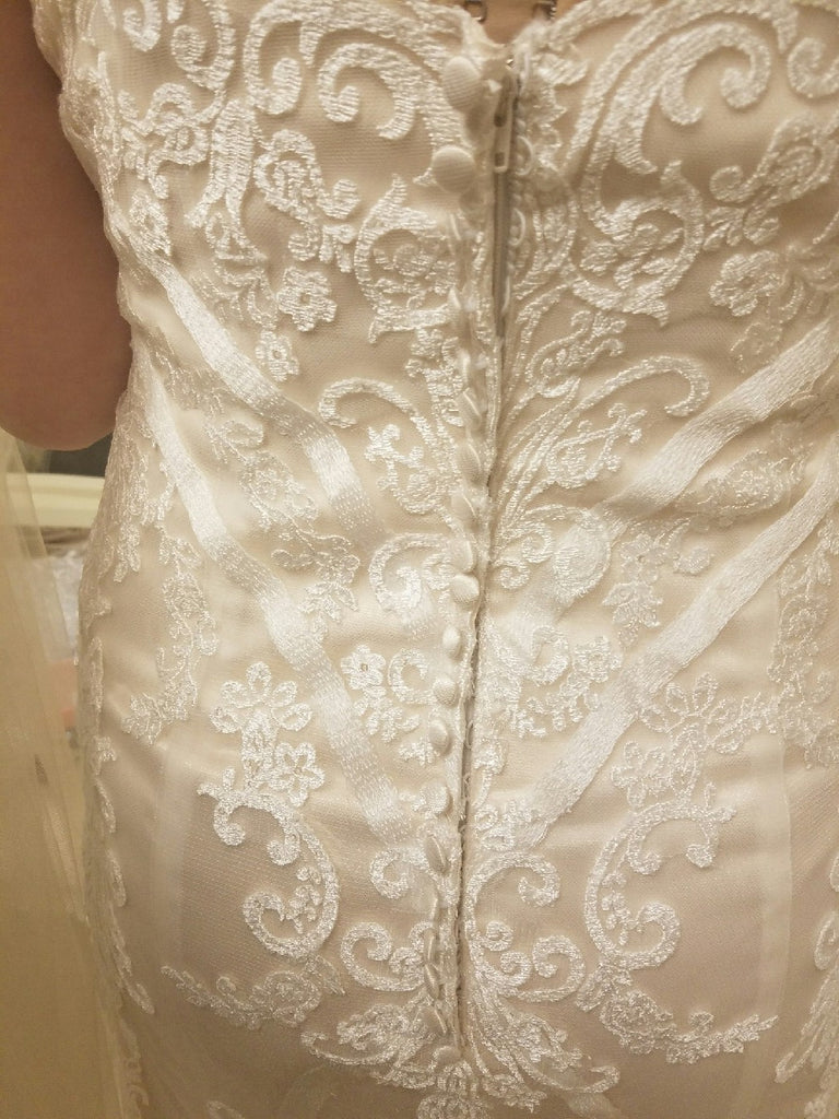 Custom Boutique 'Private Collection' size 8 new wedding dress back view close up on bride