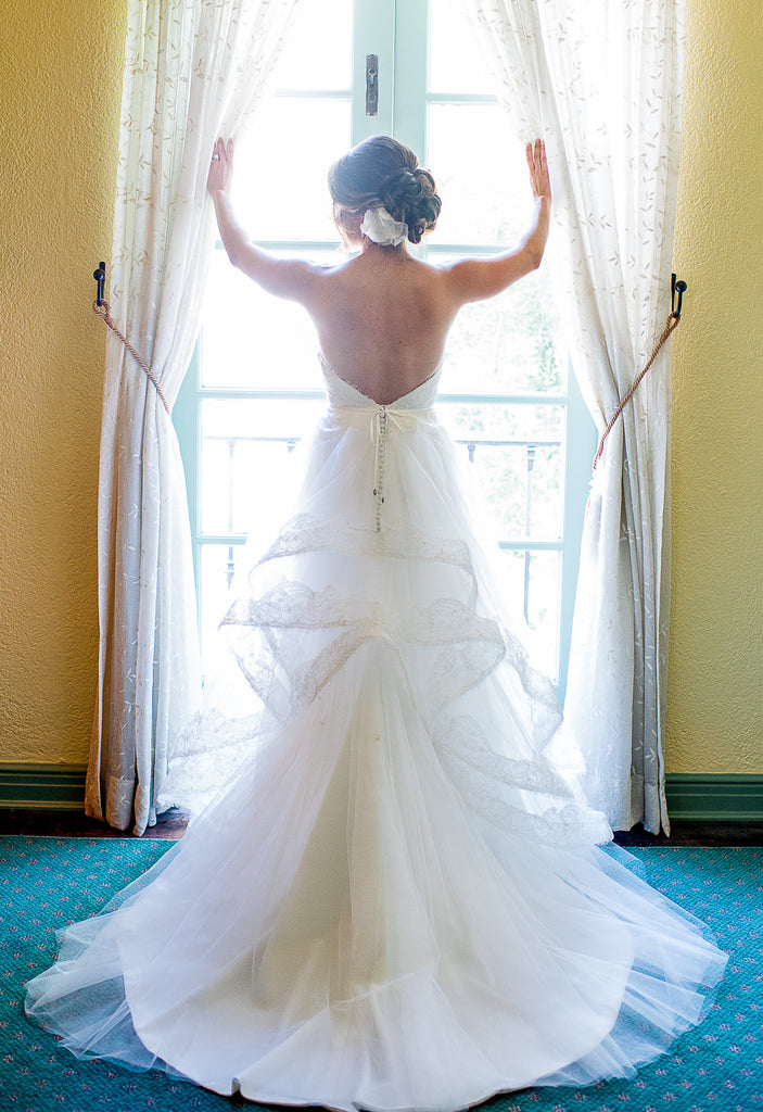 Kelly Faetanini 'Ula' size 0 used wedding dress back view on bride