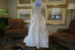 Christos 'Lace' size 4 used wedding dress front view on mannequin