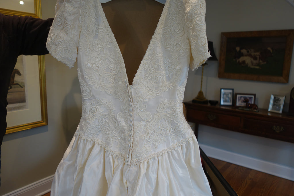Christos 'Lace' size 4 used wedding dress back view on mannequin