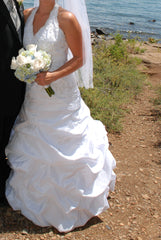 David's Bridal '9606' size 12 used wedding dress side view on bride