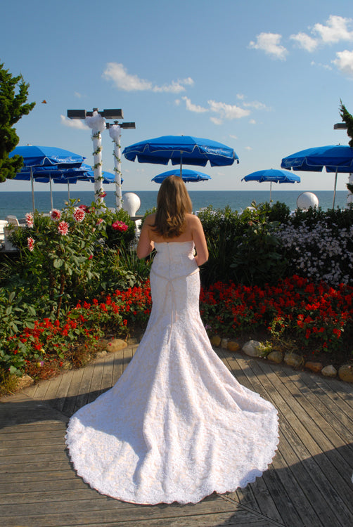 Impression Bridal 'Zurc' size 10 used wedding dress back view on bride