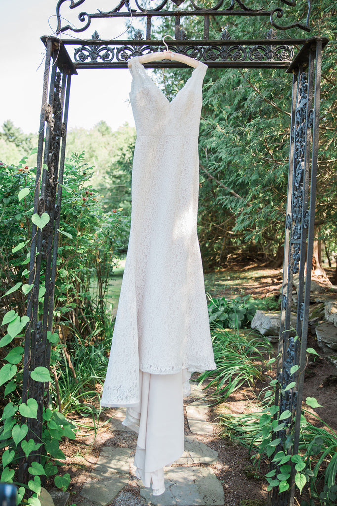 Mikaella '2016' size 4 used wedding dress front view on hanger