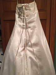 Vera Wang 'Emily' size 18 used wedding dress back view on hanger