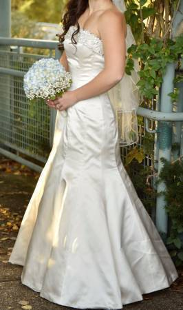Maggie Sottero 'S-R1117' size 4 used wedding dress side view on bride