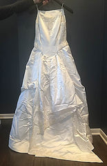 Vera Wang 'Custom Beaded' size 8 used wedding dress back view on hanger