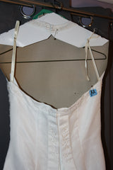 David's Bridal 'Michaelangelo' size 6 used wedding dress back view close up on hanger