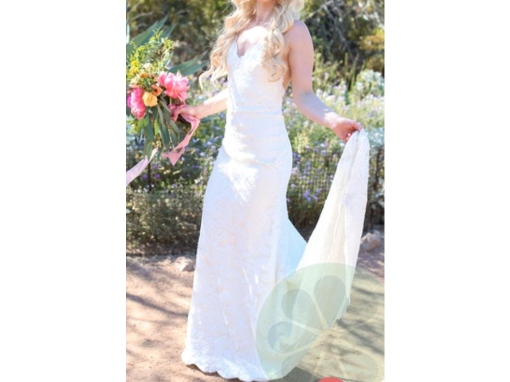 Katie May 'Poipu' size 2 used wedding dress side view on bride