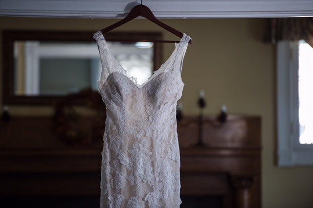 Monique Lhuillier 'Calla' size 4 used wedding dress front view on hanger
