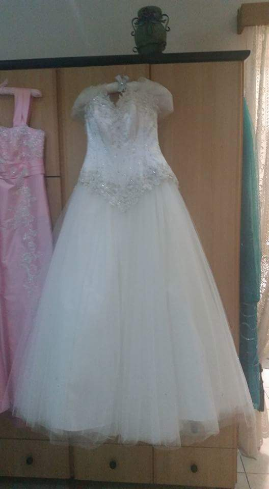 Custom 'Cinderella' size 8 used wedding dress front view on hanger