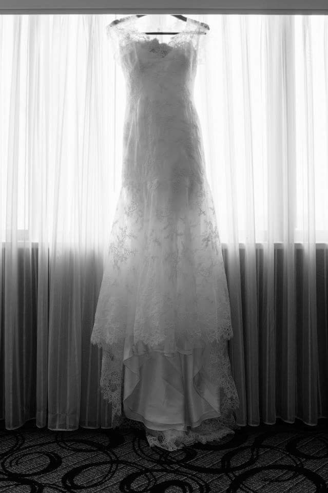 Danielle Caprese '113007' size 6 used wedding dress front view on hanger