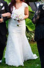 Danielle Caprese '113007' size 6 used wedding dress front view on bride