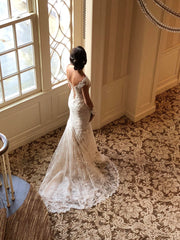 Ines Di Santo 'Madrid' size 2 used wedding dress side view on bride