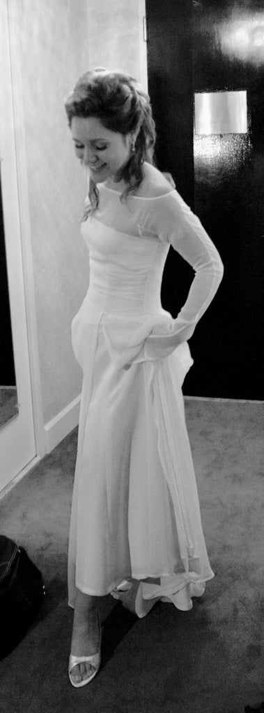 Custom 'Juliet' size 2 used wedding dress side view on bride