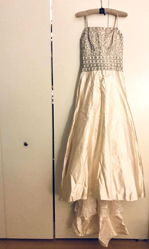 Private Collection 'Rahmanian Haute Couture' size 8 used wedding dress front view on hanger
