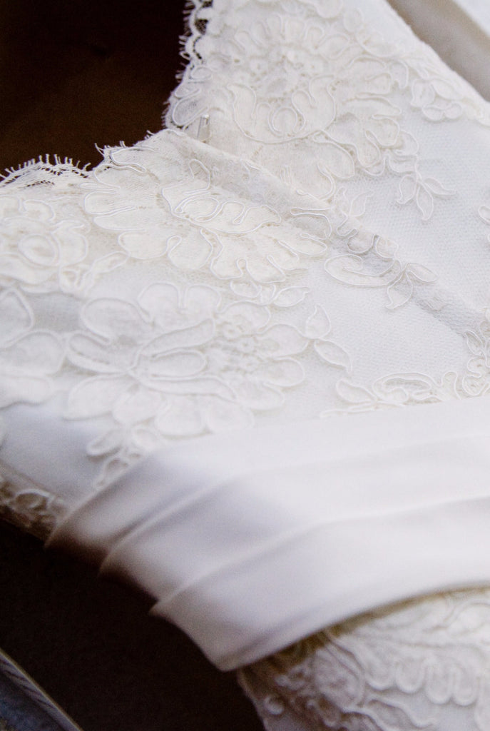 Demetrios '120' size 2 used wedding dress close up of lace