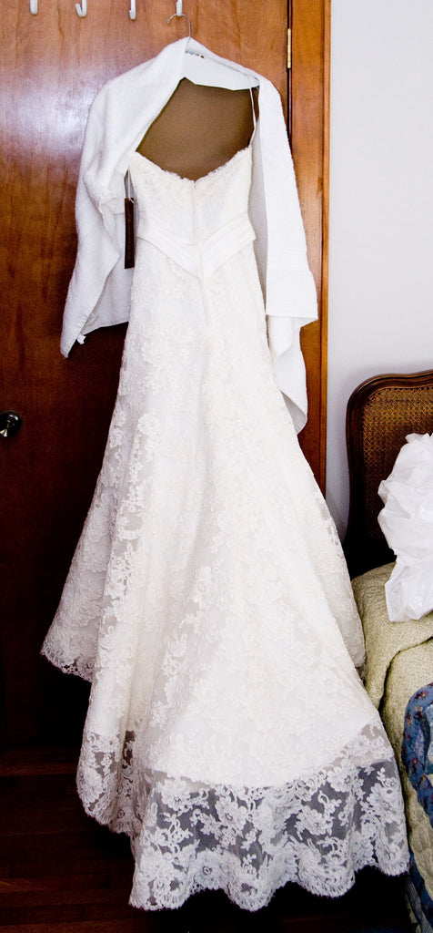 Demetrios '120' size 2 used wedding dress back view on hanger