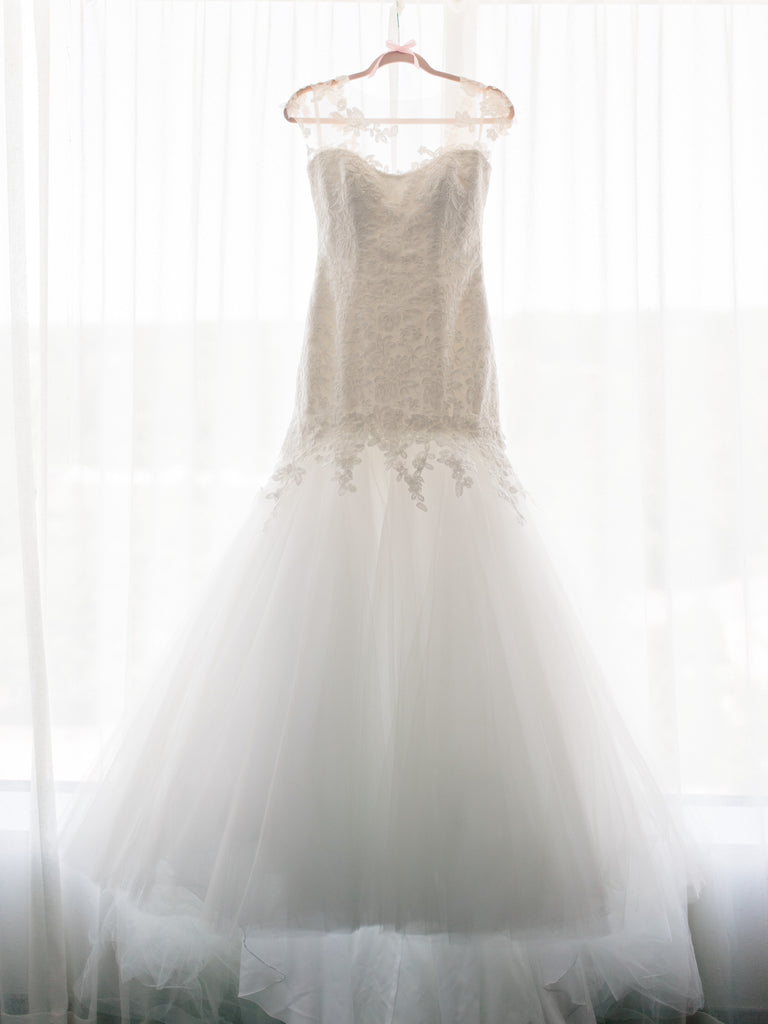 Romona Keveza 'L5100' size 8 used wedding dress front view on hanger