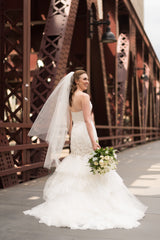 Badgley Mischka 'Ruth' size 4 used wedding dress back view on bride