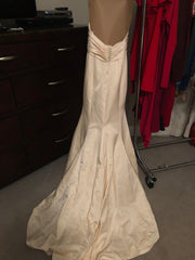 Custom 'Classic/Sexy' size 4 used wedding dress back view on hanger