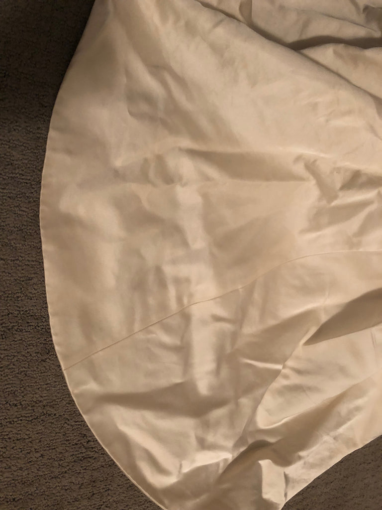 Custom 'Classic/Sexy' size 4 used wedding dress view of hem