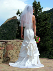 Custom 'Strapless' size 2 used wedding dress back view on bride