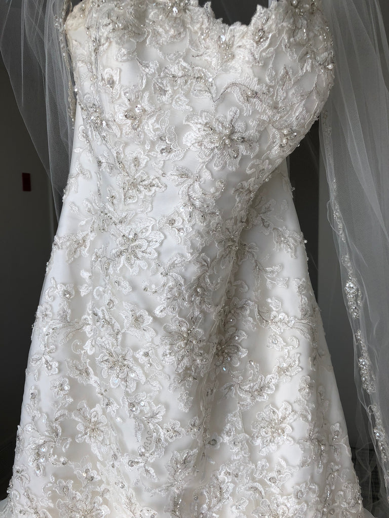 Michelle Roth 'Eda' size 10 used wedding dress front view on hanger
