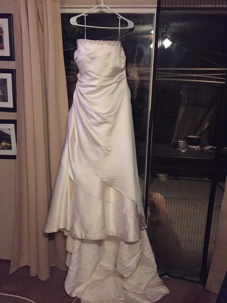 Maggie Sottero 'Jeweled' size 18 used wedding dress front view on hanger