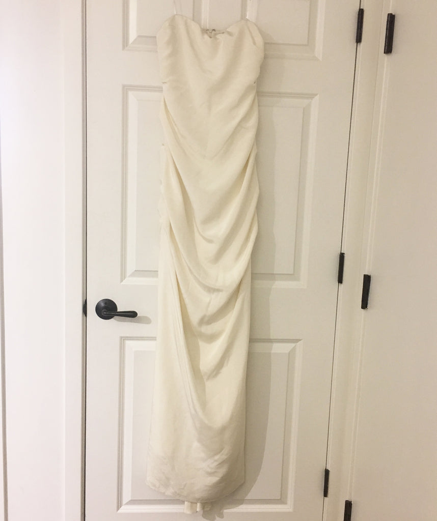 Nicole Miller 'Strapless Ruched' size 12 sample wedding dress front view on hanger